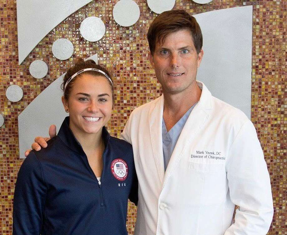 Dr. Mark Yezak, right, with Olympic hopeful diver Kassidy Cook. Watch for Cook as she competes at The Olympic Diving Team Trials on NBC on June 25 in hopes to nab a spot on Team USA for the Summer Games this year in Rio.