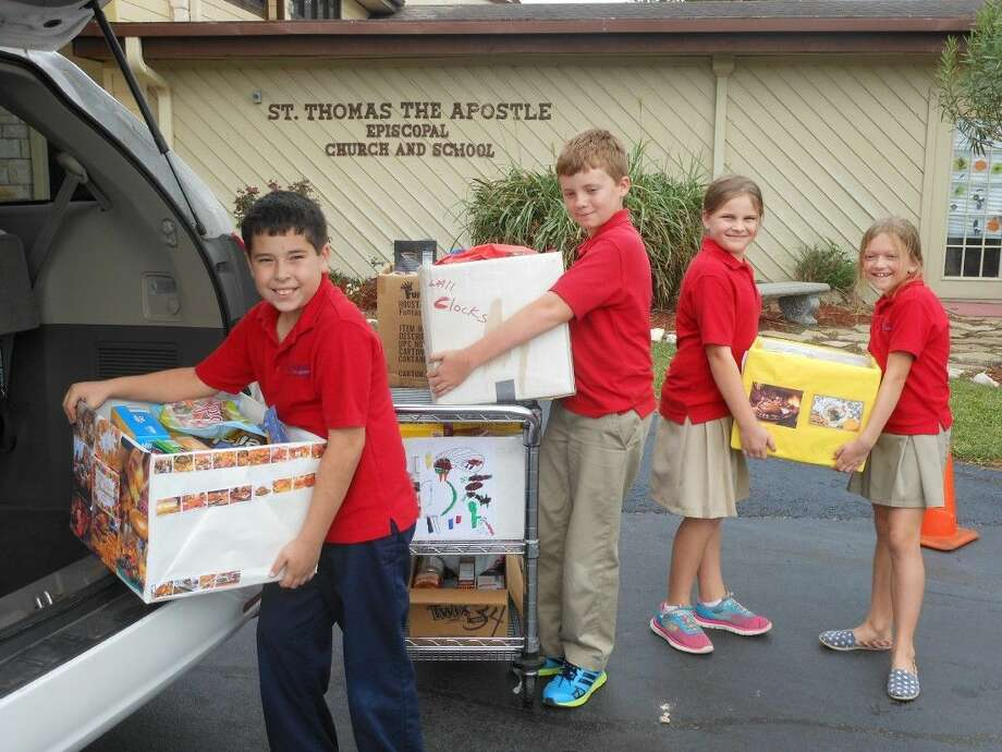 . St. Thomas the Apostle Episcopal School students collecting food for children in need in the area.