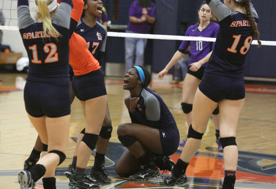 Seven Lakes' Tulani Titley celebrates a point against Jersey Village with teammates Cailin Paul, Annie Loyd, Beryl Edem and Camille Conner during the 6A Area Volleyball Playoffs, Nov. 7 at Seven Lakes High School in Katy. The Lady Spartans defeated Katy in five sets four days later to earn their first regional tournament appearance. Photo: Staff Photo By Alan Warren