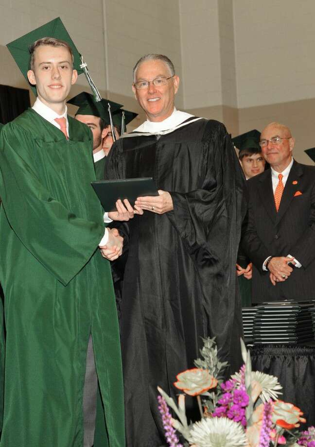 Tristan Craig, who will attend Harvard University in the fall, receives a diploma from Head of School Michael Maher.