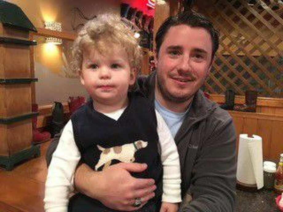 Ryan Presnal, 30, holds his son Jacob, 2, who was born while Presnal was on deployment in Afghanistan. Ryanl, who was in the Army for six years, served three tours in the Middle East and has recovered from post traumatic stress disorder.