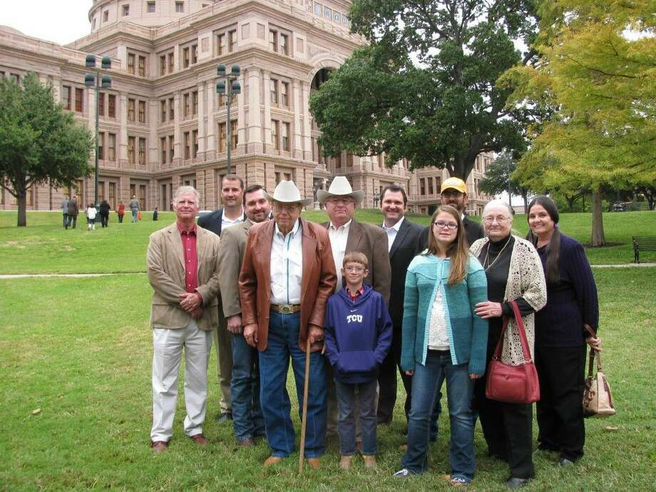 The Massey family of Hood County are shown with Brookshire Brothers District Director Kent Pursley and Brookshire Brothers Chief Executive Officer Jerry Johnson. Photo: Submitted
