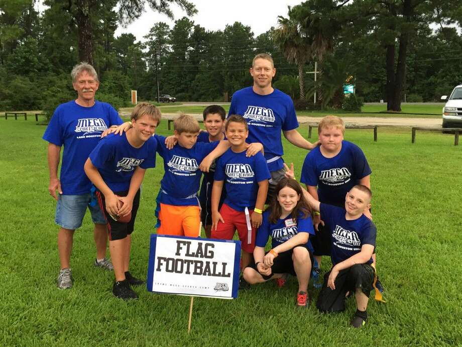 Lake Houston UMC Volunteers, Justin Rhodes and Ron Streetman, coach the flag football team, one of six sports/activities offered at EPIC Moments Mega Sports Camp VBS.
