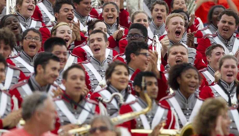 Cleveland High School Royal Braves Band members react to hearing the results of the UIL Region IX Marching Band Contest on Oct. 20 in Conroe. Cleveland ultimately scored all 1s. Photo: Jason Fochtman