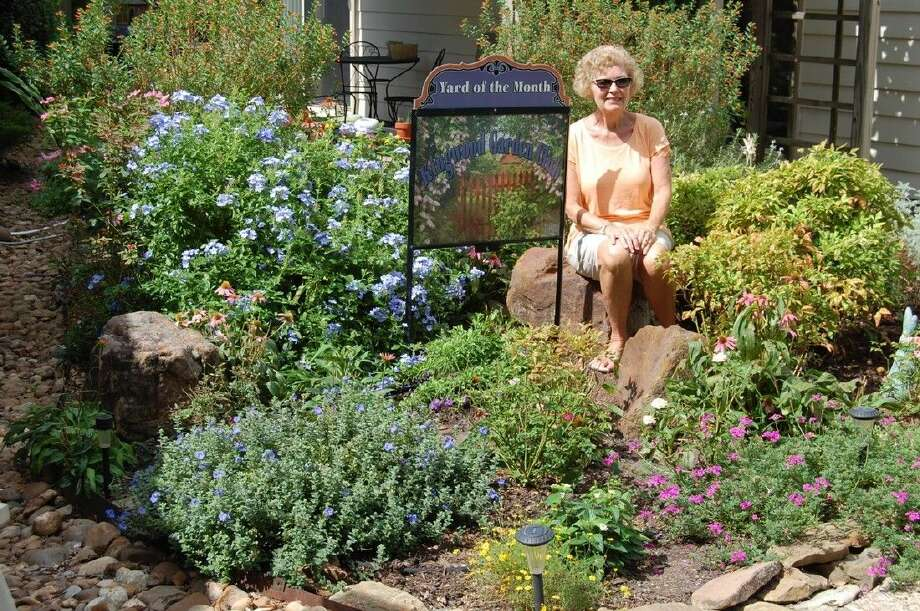 The winner of Kingwood Garden Club's November Yard of the Month is the Enchanted Garden of Jan and George Fish at 3427 Cape Forest Drive. Jan is a Master Gardener and first remembers gardening with her grandfather as a very young girl.