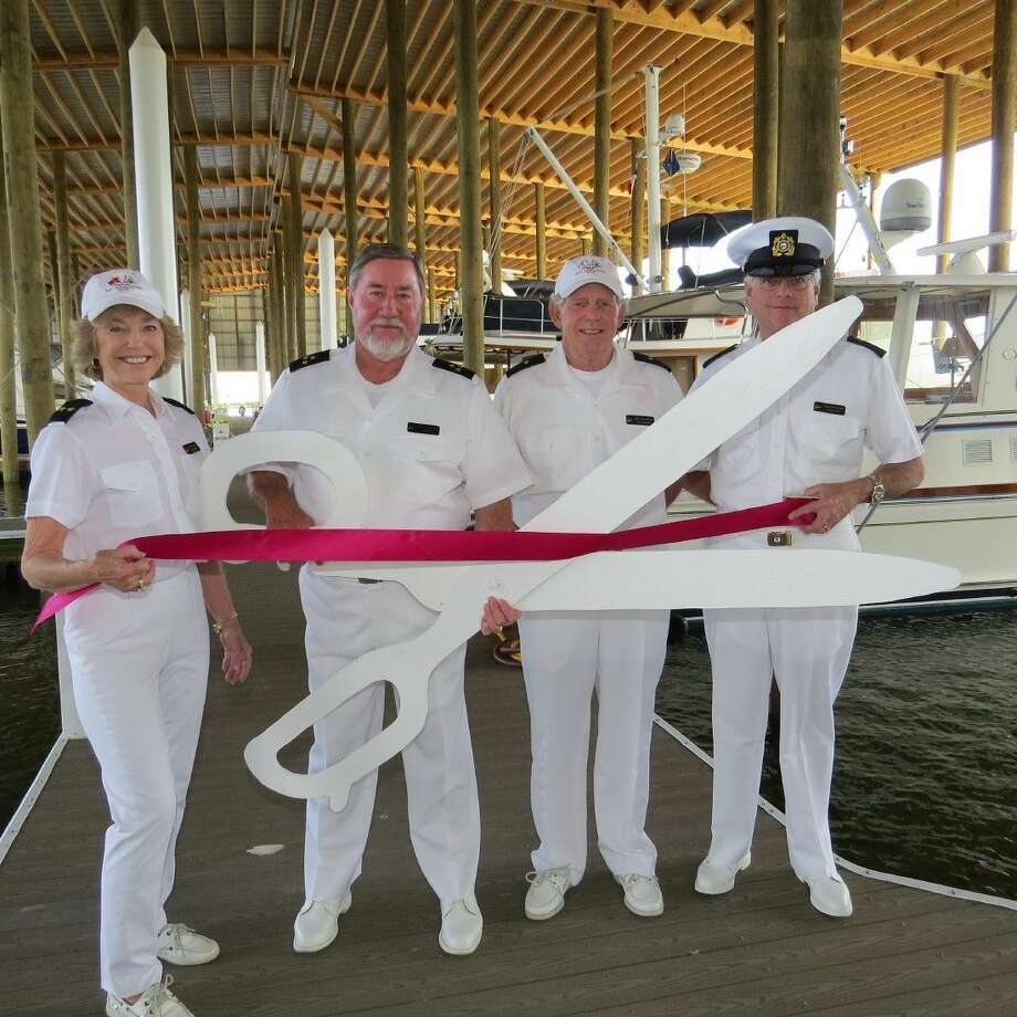 Cutting the ribbon to open B shed for occupancy on Sun., Nov. 2,at Lakewood Yacht Club were Vice Commodore Joyce Maxwell, Commodore Tom Collier, Rear Commodore Don Mitchell, and Fleet Captain Jim Winton. Photo: Picasa