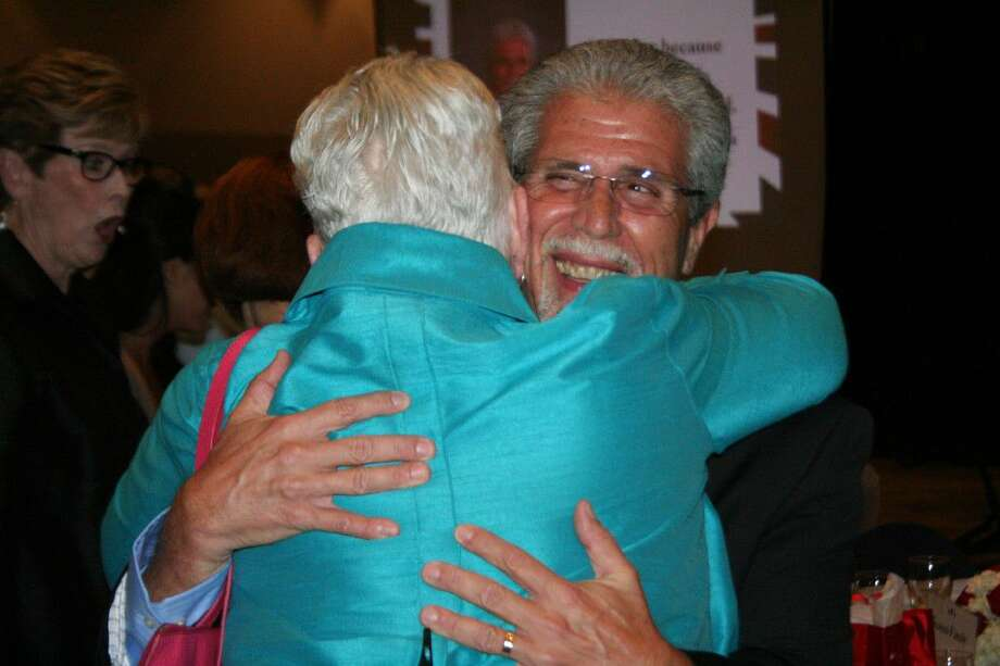 Humble ISD's retiring superintendent Dr. Guy Sconzo receives a hug from board member Nancy Morrison during the retirement celebration Friday, June 3, 2016.