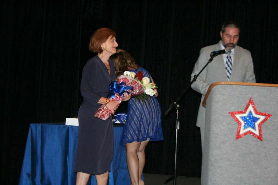 Dr. Guy Sconzo's wife, Diane Sconzo, was honored for her continuous support.