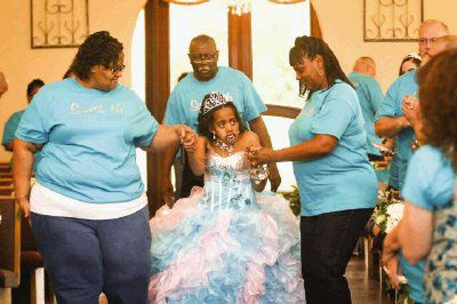Lauryn Williams, escorted by her mother Lacoshia, celebrates her 16th birthday on Saturday at Heather's Glen in Conroe. Photo: Michael Minasi