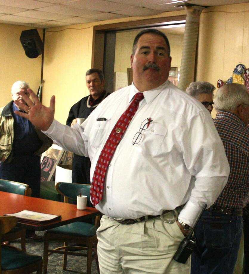 San Jacinto County Sheriff Greg Capers greets his guests at the reception held at Paradise Grill after returning from a dead on arrival. Photo: Jacob McAdams