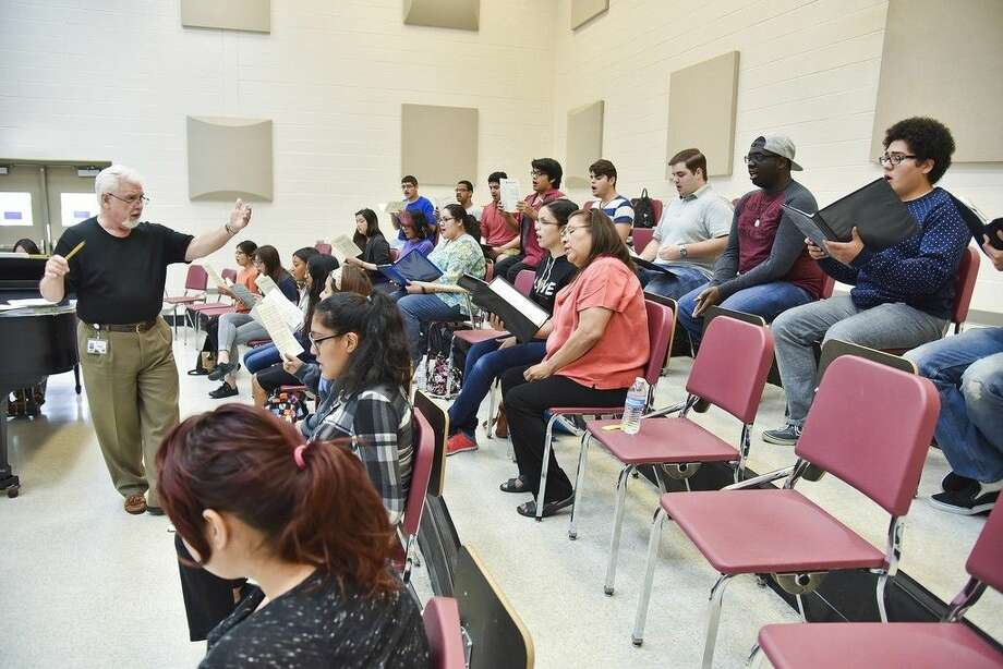 San Jacinto College music professor Edgar Moore, left, leads choral students in rehearsal for a concert set for Dec. 2 at the North Campus. Photo credit: Rob Vanya, San Jacinto College marketing, public relations, and government affairs department.