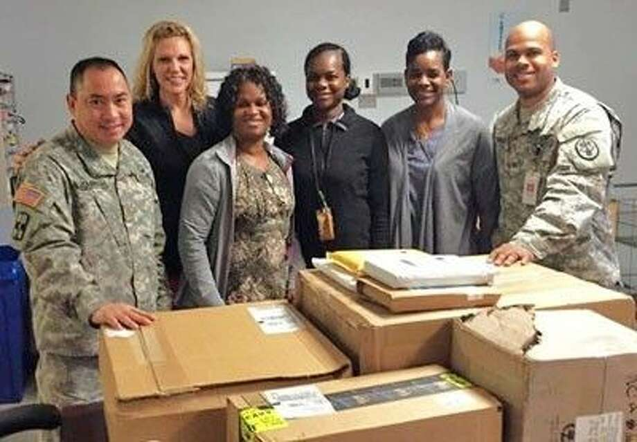 Staff at on the behavioral ward of William Beaumont Army Medical Center in El Paso receiving supplies purchased with proceeds from last year's Pearland Veterans Day Walk.