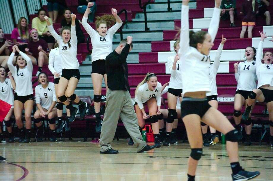 Clear Creek head coach Scott Simonds and the Lady Wildcats celebrate a point against Clear Springs Tuesday night. Photo: KIRK SIDES