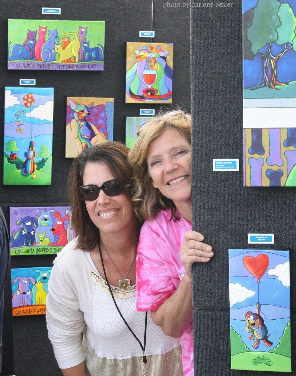 Chrissy Doolen (left) with April Murphy in Murphy's booth at First Saturday Arts Market in the Houston Heights.