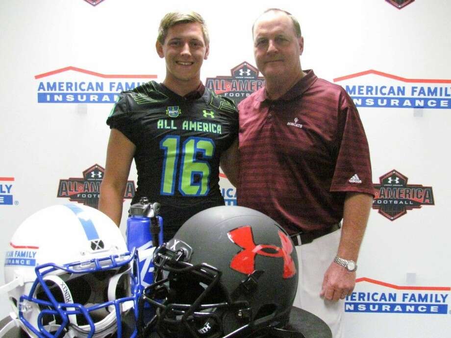 Cy-Fair All-American kicker Braden Mann is flanked by head coach Ed Putejovsky. Photo: Miguel Torres