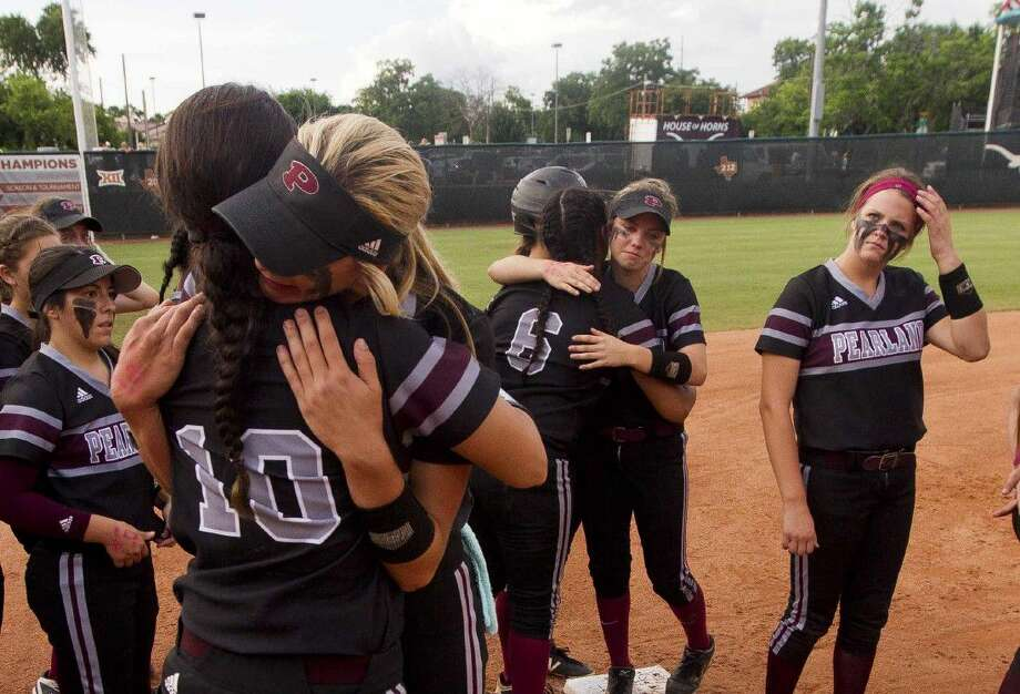 Pearland's Alyssa Denham gets a hug from Sydney Gutierrez after losing the 6A state final at the UIL State Softball Championships in Austin Saturday. Keller shutout Pearland 5-0. Go to HCNpics.com to view more photos from the game. Photo: Jason Fochtman