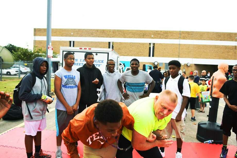 Wunderlich Intermediate Science Fair, Officer R.Dearive of Klein PD shows self-defense example to students. Photo: Tony Gaines