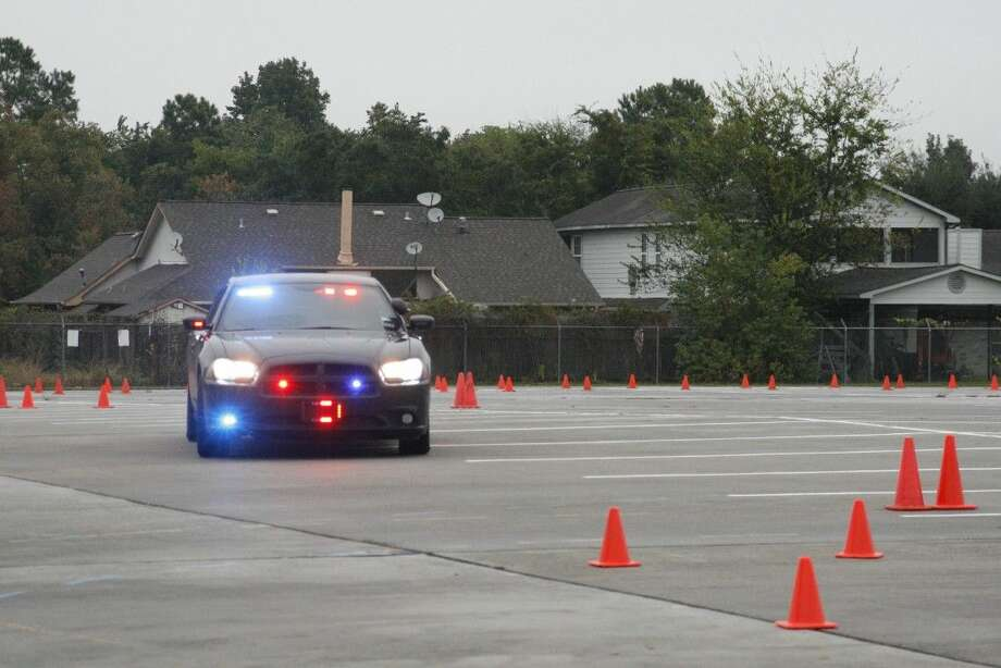 A police cruiser maneuvers through a training course for police officers in Humble on Nov. 6, 2014.