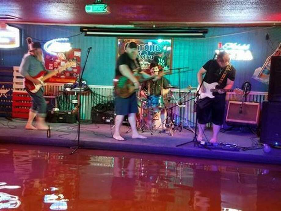 Later that evening, Pushwater, who was on tour, hit the stage to perform for guests at Crosby's Bob N Jeans in a video that has now gone viral showing dancers and patrons enjoying the show despite approximately three-to-four-feet of water in the bar.