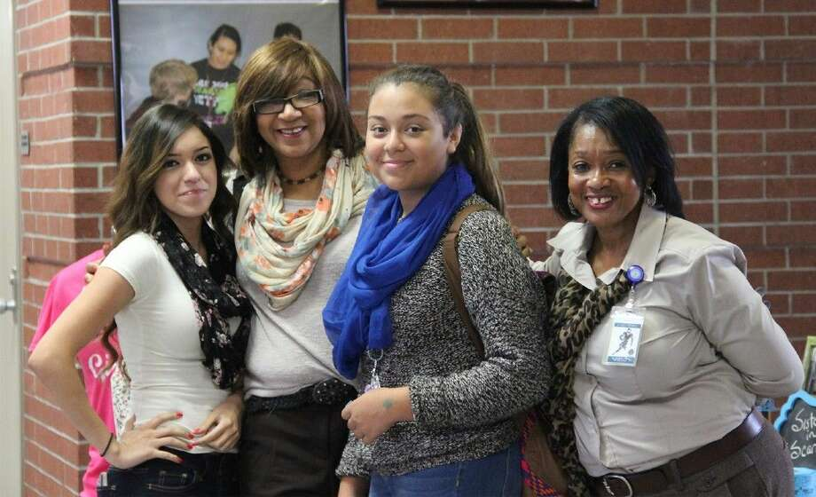 Cypress Springs High School students and staff celebrate Girl Empowerment Week at the school by wearing scarves on Tuesday. Pictured, from L-R, are sophomore Casandra Gonzalez, teacher Charlene Johnson, freshman Elisheida Chanona and assistant principal Sandra Cahee. Photo: Quidijah Maldonado