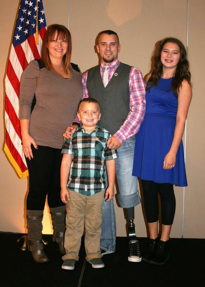 Iraq war veteran Brandon Byers, poses with his family, Megan, Cameron and Preston, on Nov. 6, when he was the guest speaker at the monthly GCCOC luncheon. Photo: Stephanie Buckner