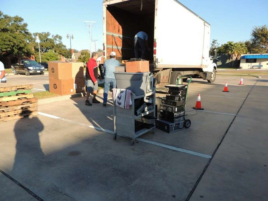 R.A.K.I. employees load up electronics for proper disposal. Photo: Submitted Image