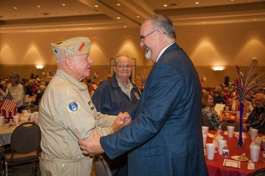 Commissioner R. Jack Cagle meets with veteran John Heimburger during last year's Veterans Day celebration at the Humble Civic Center.