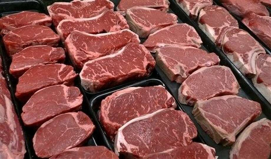 The meat industry is seeing red over the dietary guidelines. The World Health Organization's cancer agency says Monday that processed meats such as ham and sausage can lead to colon and other cancers, and red meat is probably cancer-causing as well. Photo: J. Scott Applewhite