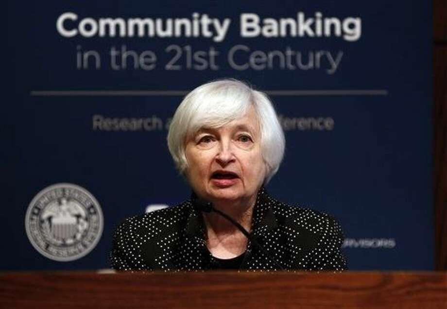 Federal Reserve Chair Janet Yellen speaks to a conference of bankers and financial leaders at the Federal Reserve Bank of St. Louis, in St. Louis. Doubts are rising that the Fed will start raising rates before next year from the record lows where they've stood since 2008. Photo: Jeff Roberson