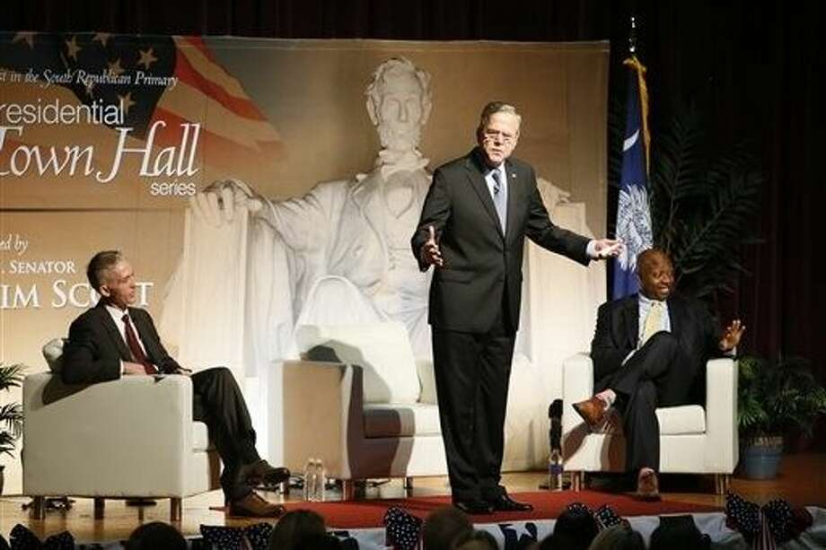 Republican presidential candidate Jeb Bush addresses the crowd as Rep. Trey Gowdy, R-S.C.,left, and U.S. Sen. Tim Scott R-S.C. listen during a town hall event Saturday at Bishop England High School on Daniel Island, S.C. Photo: Paul Zoeller