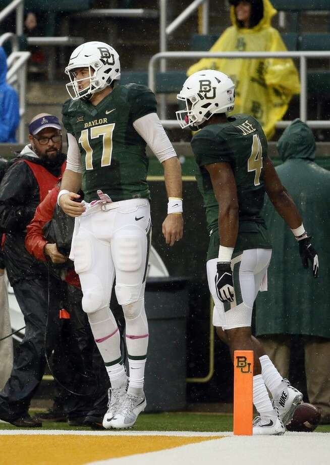 Baylor quarterback Seth Russell (17) and wide receiver Jay Lee (4) celebrate a Russell touchdown against Iowa State.