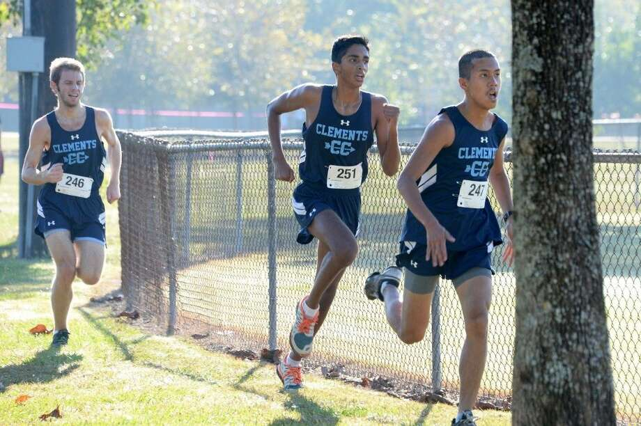 Clements runners (from right) Danny Maas, Brihunan Sundararaman and Galen Lytle took three of the top four spots to lead the Rangers to the District 23-6A championship, Oct. 15 at Bear Creek Park in Houston. Visit HCNPics.com for more photos. Photo: Craig Moseley
