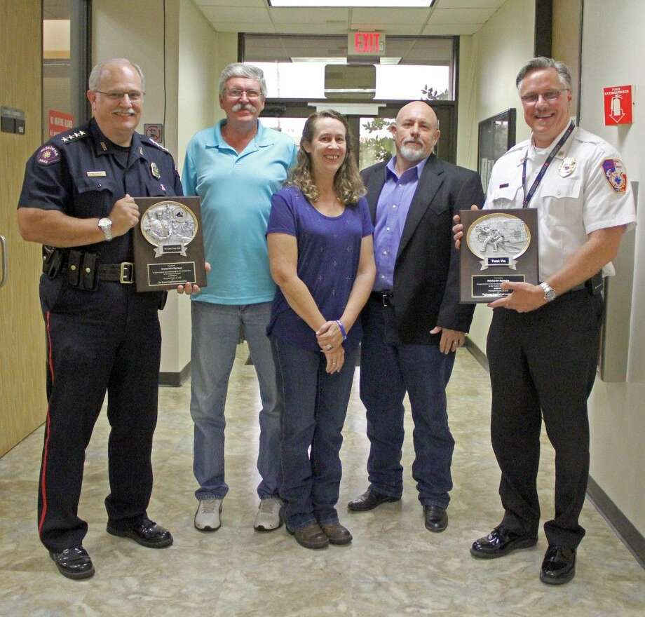 The Queens Neighborhood Association recently recognized Pasadena Police Chief Michael Thaler and Fire Chief Lanny Armstrong for their service to the community. Pictured from the left: Police Chief Michael Thaler, Queens Neighborhood Association members Kevin Anderson, Brenda Anderson (secretary), Lonnie Smith (president) and Fire Chief Lanny Armstrong. Photo: Kristi Nix