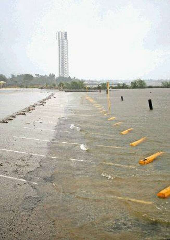 Water encroaches the parking lot at Clear Lake Park as the remnants of Hurricane Patricia passes through Houston on Sunday, October 25, 2015. Photo: Kar B Hlava