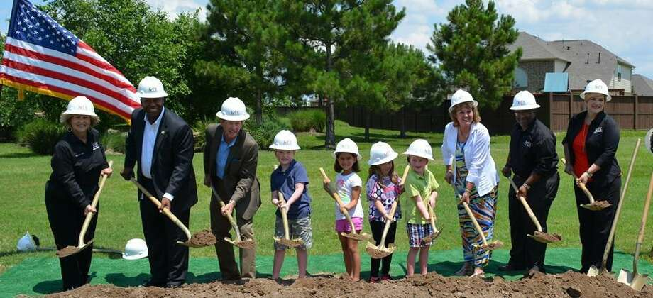 KISD school board members, school namesakes Robert (third from left) and Felice (third from right) Bryant and future students turn over dirt to symbolize the beginning of work on Bryant Elementary this past Tuesday, June 7. Set to open in fall 2017 in Young Ranch, the school is one of new six campuses included in the 2014 voter-approved bond program.