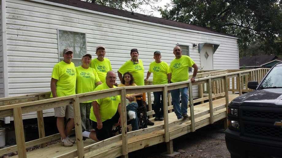 The Men's Ministry of Lamb of God Lutheran Church, Humble recently completed a ramp for a local resident, Les who had part of his leg amputated. This is the after photo with the completed ramp.