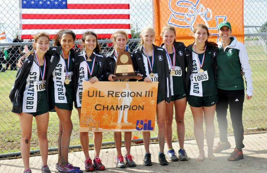 The Stratford girls cross country team shows off their Region III-5A championship banner after they won the Regional meet Monday morning at Sam Houston State University in Huntsville. The Spartans scored just 47 points and will now head to the 5A state meet next Saturday at Old Settler's Park in Round Rock. From the left, sophomore Maddie Harms, freshman Isabella Terrazas, senior Abigail Hirst, freshman Grace Custer, sophomore Sydney Lawrence, freshman Georgia Harper, and junior Caroline Crawford along with head coach Jennifer Clouse made up the winning team.