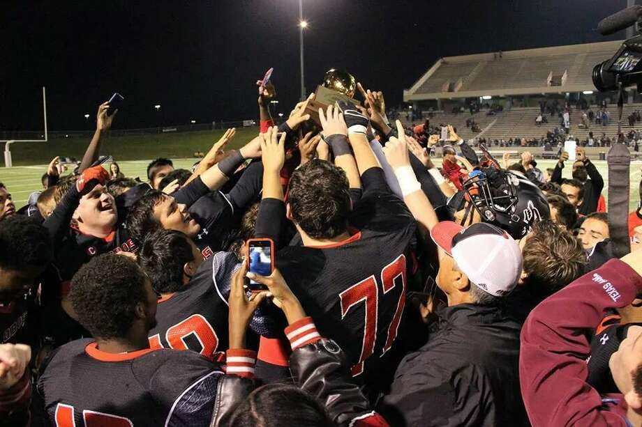 Langham Creek football celebrates its second district title in three years Friday at Pridgeon Stadium. Photo: Samantha Deike/Langham Creek HS