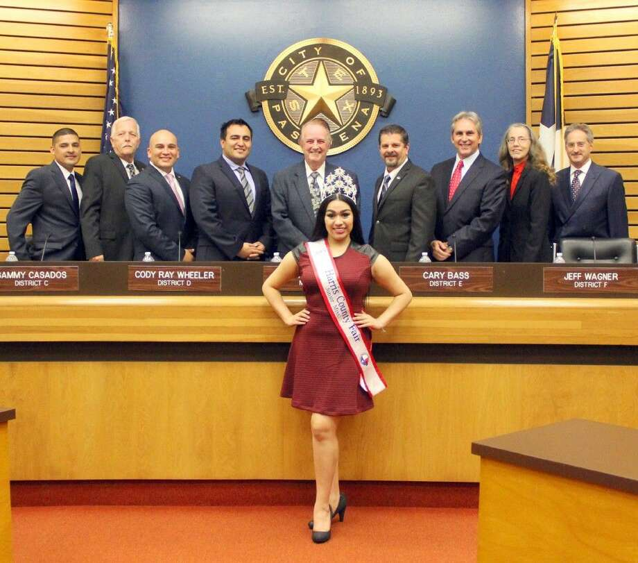 The Pasadena City Council received a visit from Harris County royalty recently. Pictured in front: Harris County Junior Miss Angelica Martinez (back row, left to right): Councilmember Ornaldo Ybarra, Bruce Leamon, Sammy Casados, Cody Ray Wheeler, Mayor Johnny Isbell, Councilmembers Cary Bass, Jeff Wagner, Pay Van Houte, Darrell Morrison Photo: Kristi Nix