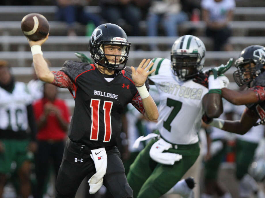 Austin's Jackson Steele throws against the Hightower defense during game at Mercer Stadium in Sugar Land, Texas on Friday, September 12, 2014. To view or purchase this photo and others like it, go to HCNPics.com. Photo: Staff Photo By Alan Warren
