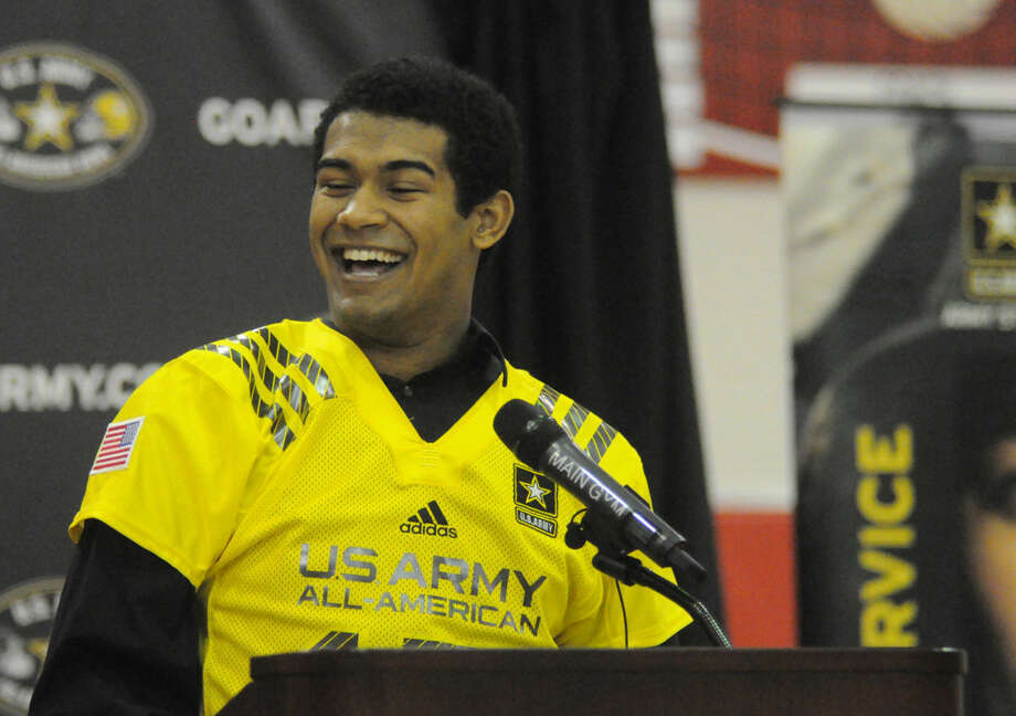 Splendora's Jay Bradford cracks a smile while accepting an invitation to play in the U.S. Army All-American Bowl at a ceremony held at Splendora High School on Monday. Photo: Keith MacPherson