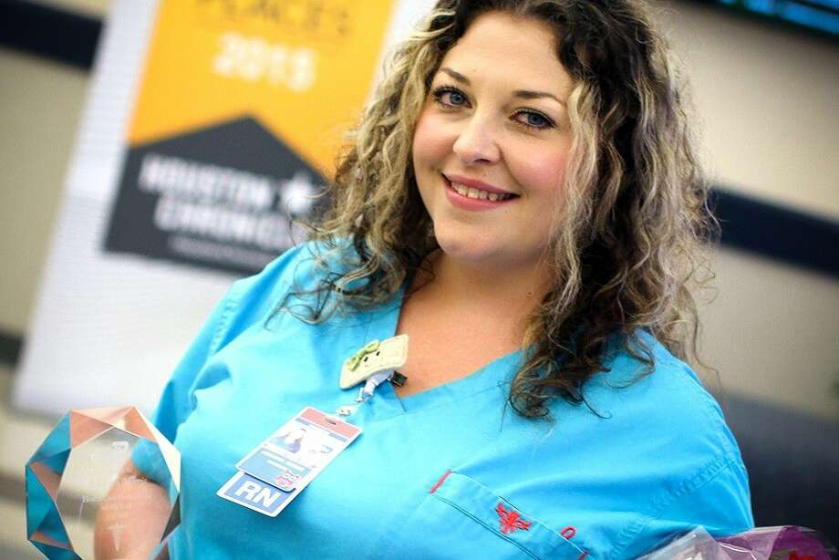 Fisher Elementary nurse Ashleigh Morris receives a plaque after being named the Pasadena ISD Health Care Professional of the Year.