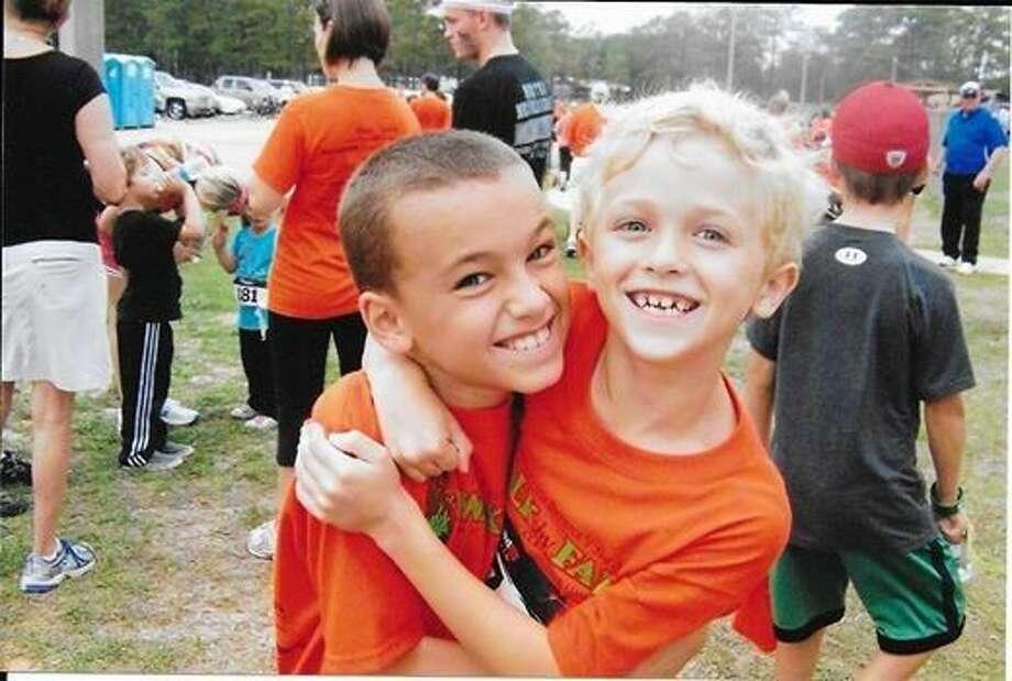 Barrett Kenny, left, with Landon Ahrendt at a past Addi's Faith Foundation Walk by Faith 5K.
