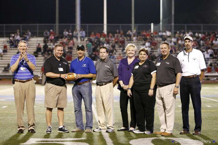 Houston Methodist St. John Hospital is honored for their commitment to Friendswood High School Athletics and high school student athletes. (L to R) Mark Griffon, Friendswood High School principal; Jonathan Utsey, athletic trainer; David Montz, school board member; Dr. Daniel O'Neill, orthopedic surgeon, sports medicine specialist and team doctor; Trish Hanks, Friendswood ISD superintendent; Cathy Supak, Houston Methodist Orthopedics & Sports Medicine athletic trainer; Jason Tindall, physician liaison; and Thad Roher, Friendswood ISD deputy superintendent. Photo: Paul Cacciapaglia