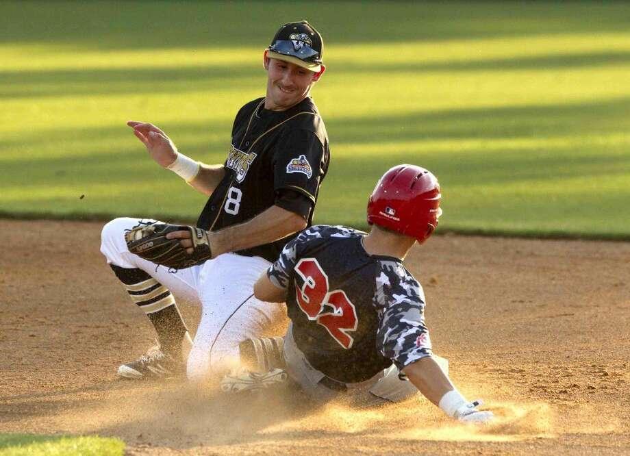 Strykers shortstop Jonathan Ducoff fields a throw Thursday.