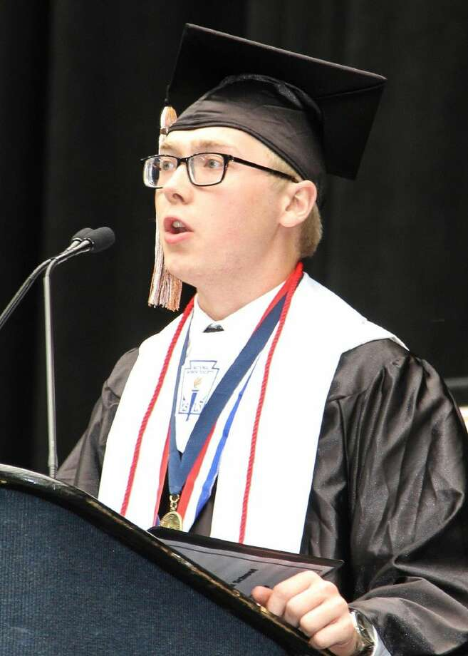 Devin Tucker delivers commencement speech at the Lewis CTHS inaugural graduation ceremony.