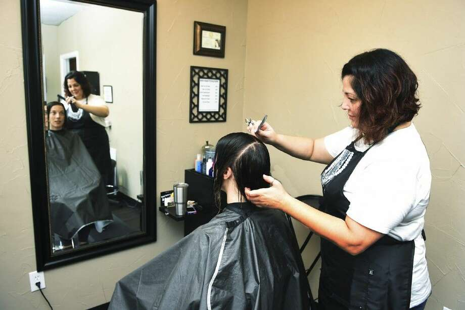 Angela Spenrath works on a client's hair at The Haven on Main which opened in July. Photo: Tony Gaines