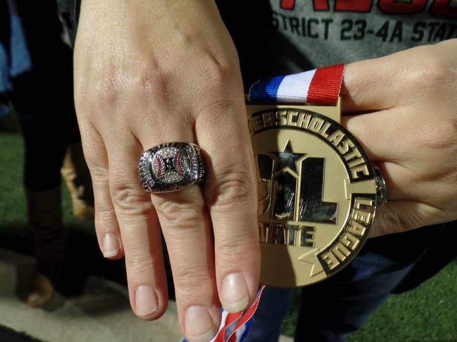 A Huffman softball players shows off her State Championship ring from the 2015 Huffman Softball State Championship, the first in school history.