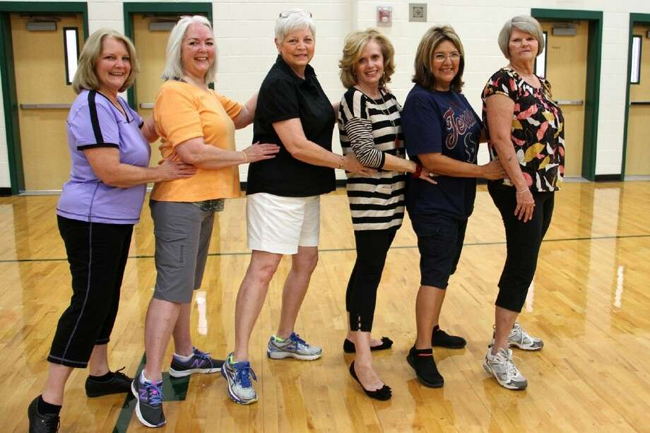 A few members of the original Eagle Escort drill team pose at a practice in September. From left to right: Wanda Bunch Hayes, Janice Jones Baggett, Charlotte Putnam Larson, Montie Dykes Pennington, Rosie Casas Rocha and Vickie Show Tiemann.