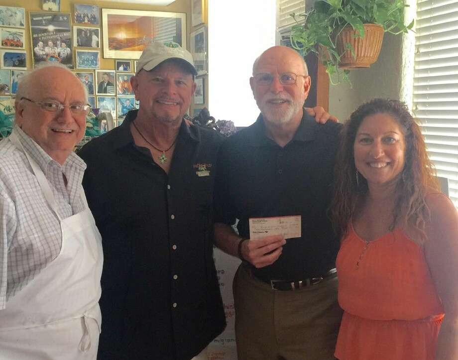 Left to right, Frankie Camera, owner of Frenchies Restaurant; Kelly McGuire-Redfish Island Music; Richard Gruen-Boys & Girls Harbor; Sandy Records-Redfish Island Music.